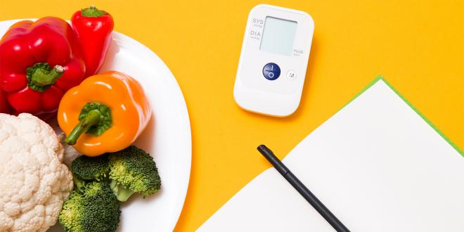 a journal, a blood pressure monitor, and a diet journal